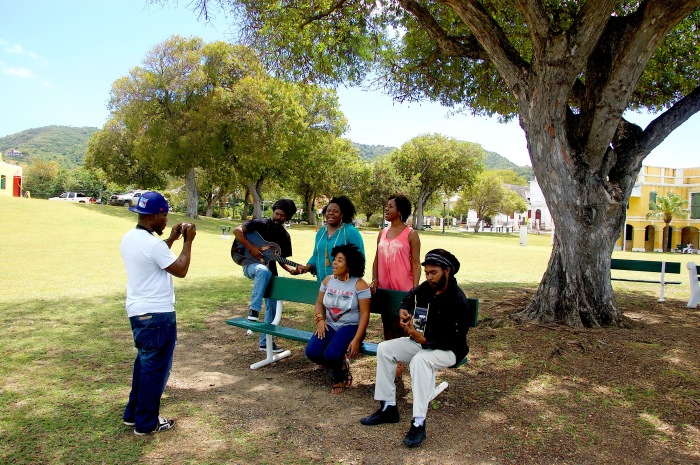 Singer and songwriter Tia, along with backup singers Letitia, Janney and Umojah - William and Bobs - perform under the tamarand tree by the fort in Christiansted, St. Croix.