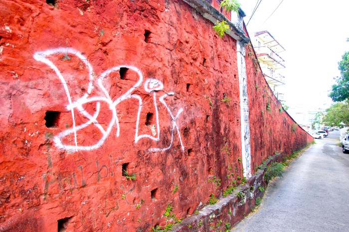 Graffiti on historic walls on Church Street in Christiansted, St. Croix. By Stephanie Hanlon