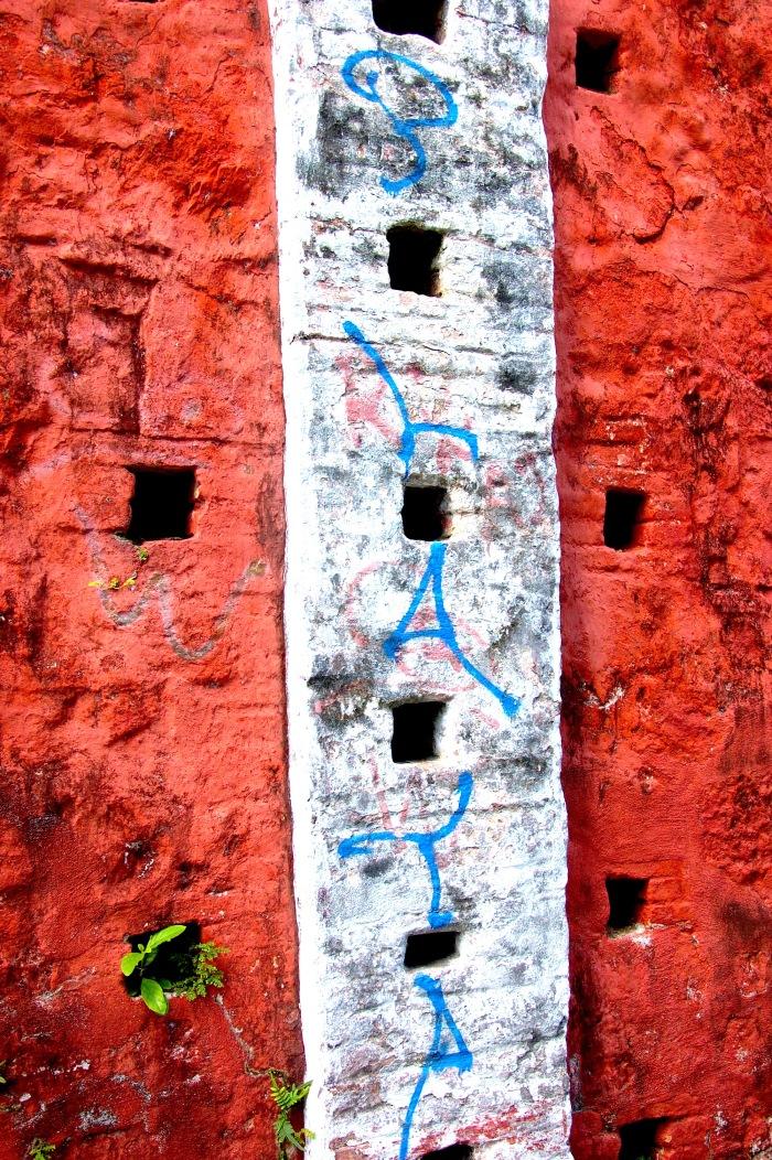 Graffiti on historic walls on Church Street in Christiansted, St. Croix. By Stephanie Hanlon